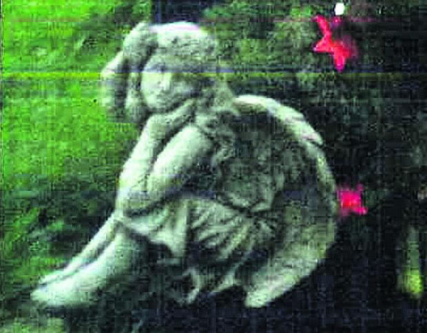 This Is Wiltshire: The angel statue which was stolen from a grave in Devizes Cemetery