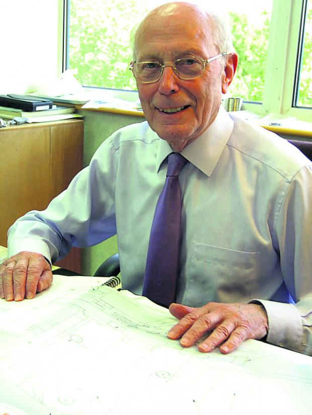 This Is Wiltshire: Ralph Flower pictured at his desk at Cross Manufacturing in Devizes