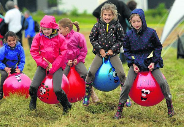 This Is Wiltshire: More than 200 Brownies put their skills to the test, including in this spacehopper race
