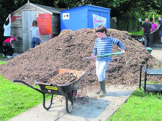 This Is Wiltshire: James Iles gets busy digging at a community day at Christian Malford Primary School