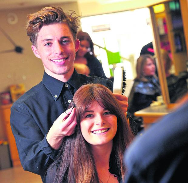 This Is Wiltshire: Joshua Goldsworthy, pictured styling Danielle Sealey's hair, is making waves in the world of hairdressing