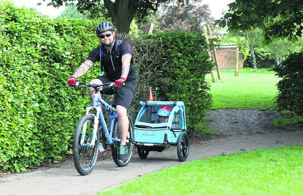 This Is Wiltshire: William Melrose riding his bike with four-year-old Corey
