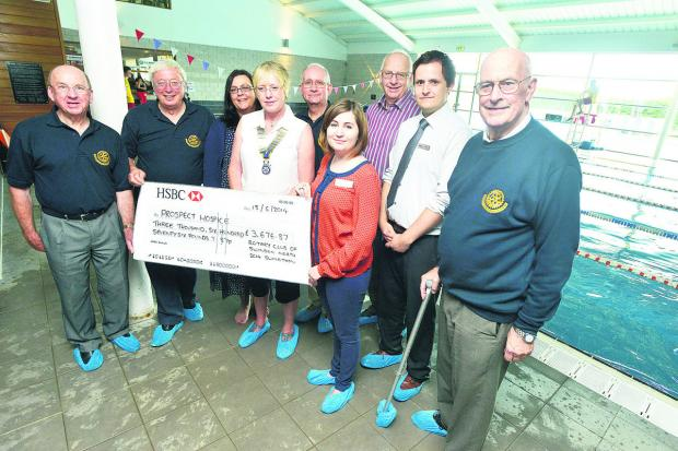 This Is Wiltshire: The Rotary Club members presenting a cheque to  Prospect Hospice