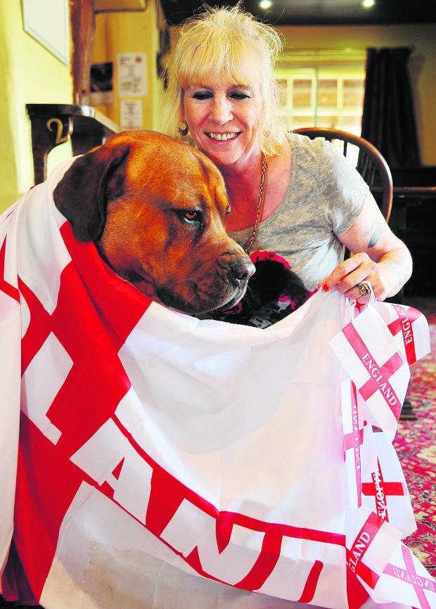 This Is Wiltshire: Cathy Kelly, landlady of The Baker's Arms, with four-legged fan Buddy