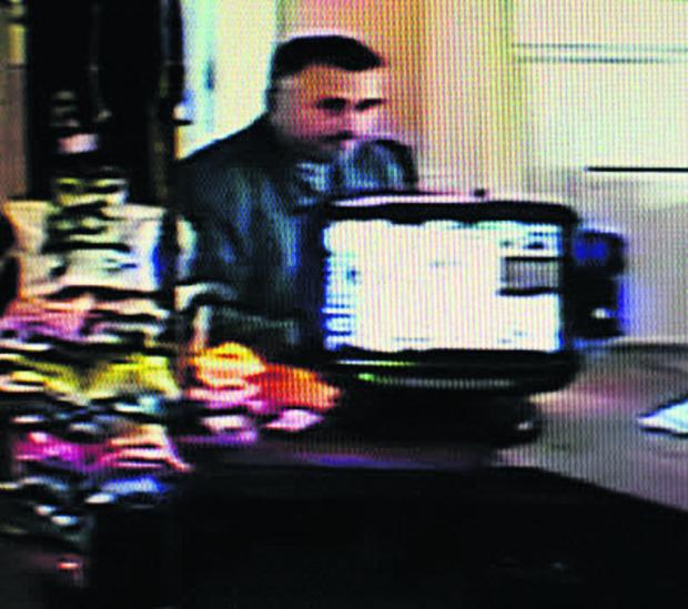 This Is Wiltshire: An image of the man at The Farmhouse Inn, Southwick, who police want to speak to about charity box thefts across Wiltshire