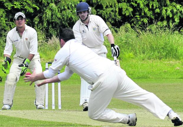 This Is Wiltshire: Trowbridge's Nick Green is caught and bowled by Nationwide House's Russell Artley during Saturday's Wiltshire Division clash at the County Ground  Photos: Glenn Phillips (49508-12-15)