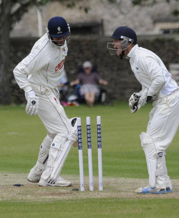 This Is Wiltshire: Norfolk's Chris Brown is out to the delight of wicket keeper Adam Miles