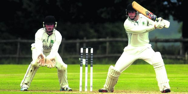 This Is Wiltshire: Marlborough's George Penfold in batting action, watched by Calne wicketkeeper Jordan Butler during their Wiltshire Division match on Saturday Pictures by Paul Morris (PM1304-0)