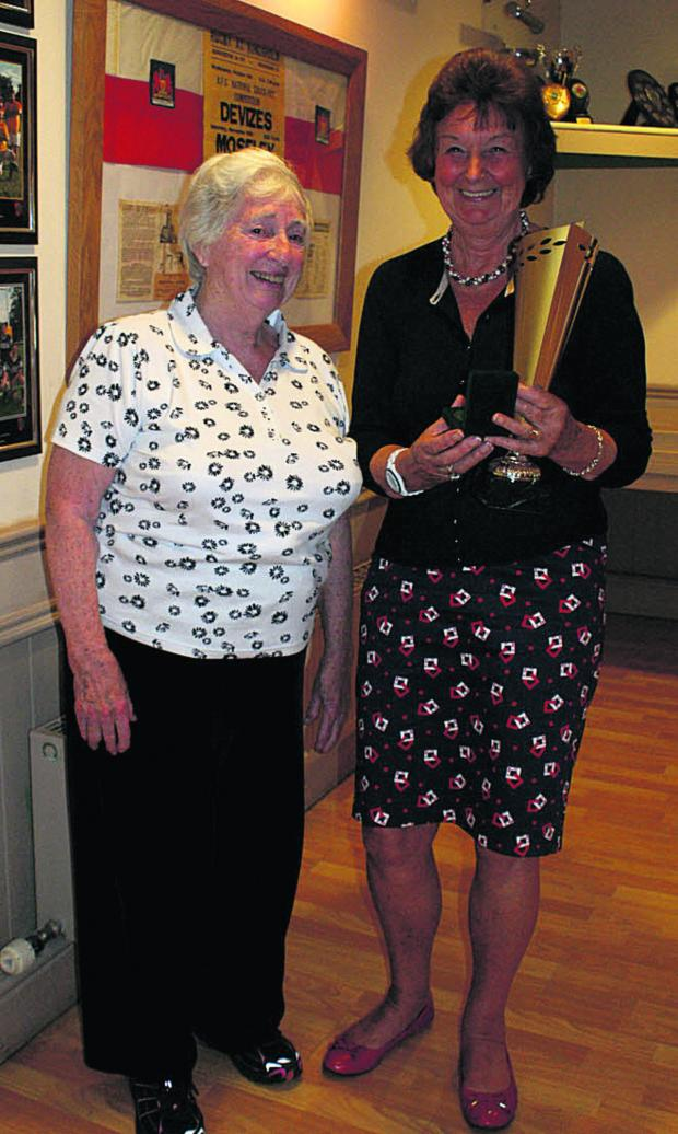 This Is Wiltshire: Barbara Barnard (right) receives her long service Award' from Wiltshire County Netball Association chair Pat Harris