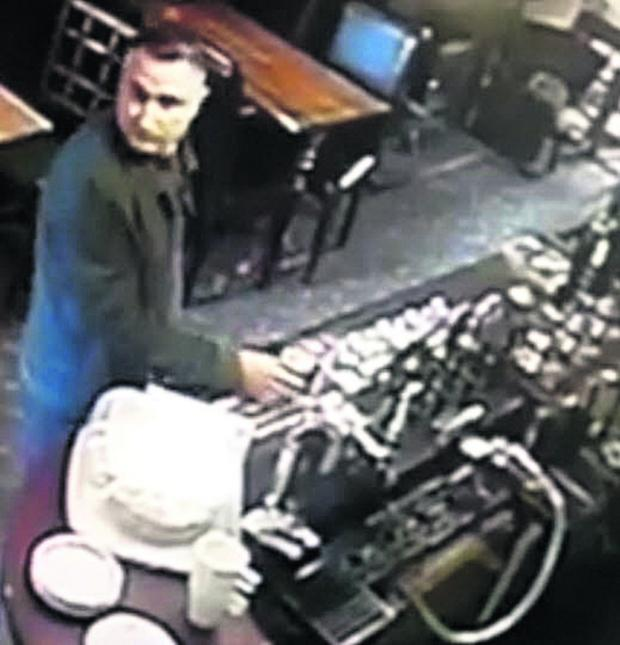 This Is Wiltshire: The Black Swan's security cameras capture the man in the act of stealing the Devizes Opportunity Centre charity box and attempting to steal another charity tin