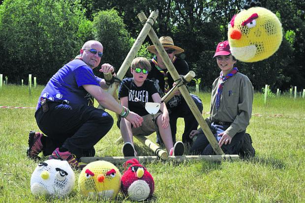 This Is Wiltshire: Scouts Will and Theo try the Angry Birds catapult made by Grahame Hiscock and Russ Cane, of Warminster
