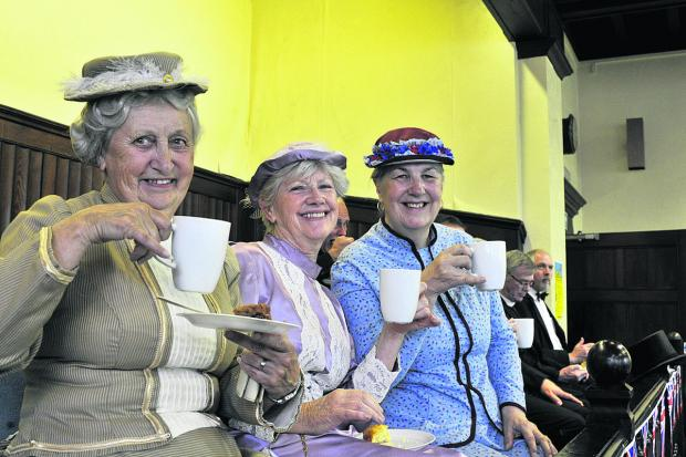 This Is Wiltshire: Stella Greaves, Sandie Brookes and Angela Giddings of the Trowbridge Players enjoy their tea, above. Inset is Trowbridge Mayor Glyn Bridges and Rosemary Hawkes of the Trowbridge Town Hall Friends with the special wooden plate