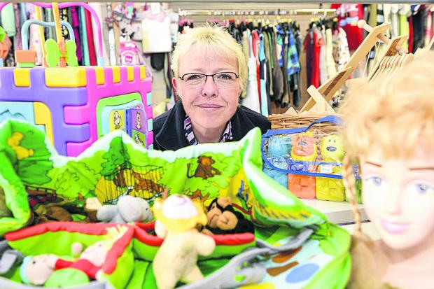 This Is Wiltshire: Alison Moore, manager of Prospect kids shop in Havelock Street, is appealing for more customers and donations
