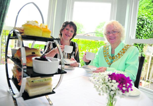 This Is Wiltshire: Sue Higgs, the general manager of Chiseldon House Hotel, with mayor Teresa Page at the open day