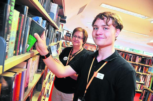 This Is Wiltshire: Liz Haywood and Louis Priday in West Swindon library, which is likely to remain at the Link Centre