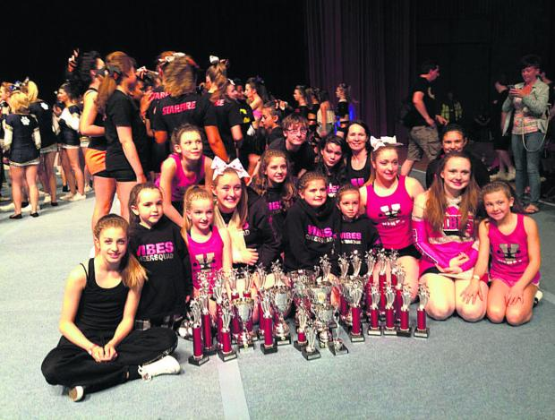 This Is Wiltshire: Chippenham Vibes pictured with their trophies gathered for all of their 25 routines in Wales