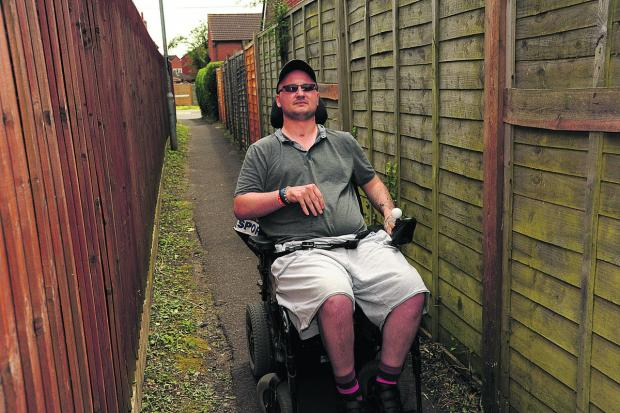This Is Wiltshire: Martyn King in the alleyway where he was threatened and robbed