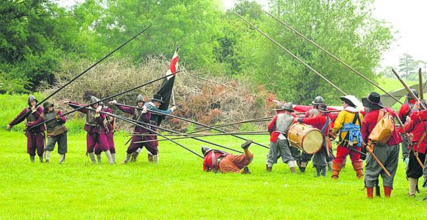 This Is Wiltshire: Combatants march into action as they recreate English Civil War fight in Malmesbury