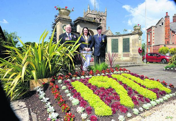 This Is Wiltshire: From left, Jeff Matthews, mayor Sarah Bridewell and Alan Thomson at the memorial display                          (PM1196) By Paul Morris