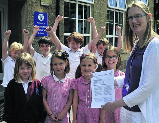 This Is Wiltshire: Headteacher Tracey Dunn and pupils celebrate Fitzmaurice Primary School's Ofsted report            Photo: Glenn Phillips (49486)