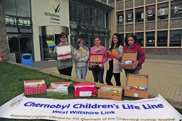 This Is Wiltshire: Christina, Megan, Tammy, Molly and Tara with their welcome boxes for the Chernobyl Children who are visiting West Wiltshire to stay for a few weeks