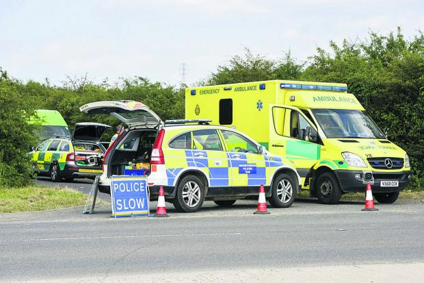 This Is Wiltshire: Police and an ambulance at Flaxlands, in Roy