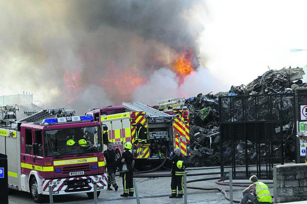 This Is Wiltshire: The fire still burning at the scrapyard at 6pm on Saturday evening. Picture by Trevor Porter