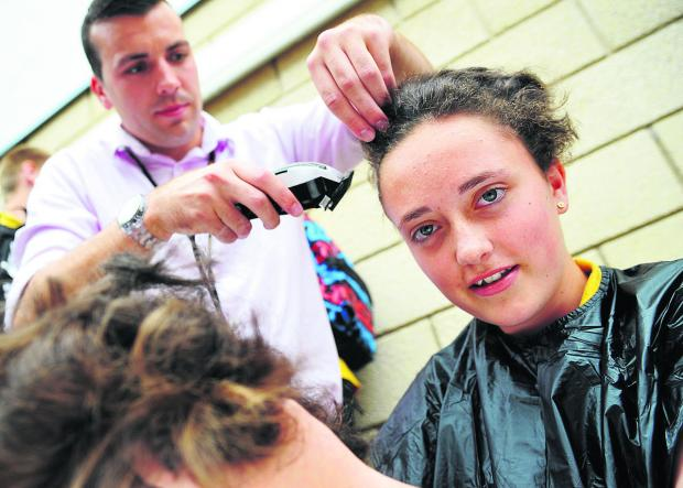 This Is Wiltshire: Craig Kent shaves off Molly Melville's hair
