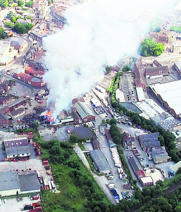 This Is Wiltshire: John Searle, who was flying in a Cessna on Saturday, took photos of the fire at E J Shanley's in Trowbridge