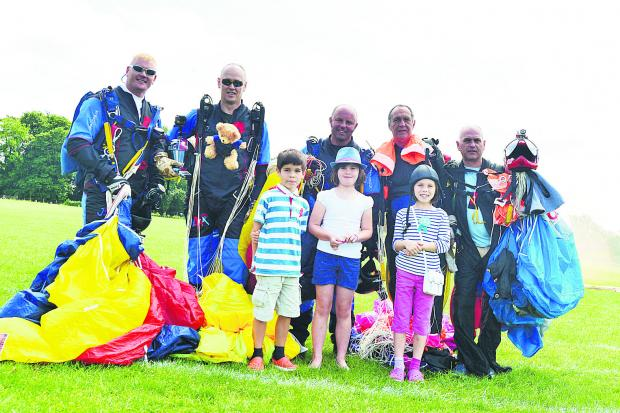 This Is Wiltshire: Dean Hoskins, Vincent Allen, Tom Blakey, Ian Marshall and Chris Mizzi with Connor, Lydia and Hannah who took part in the teddy bear drop