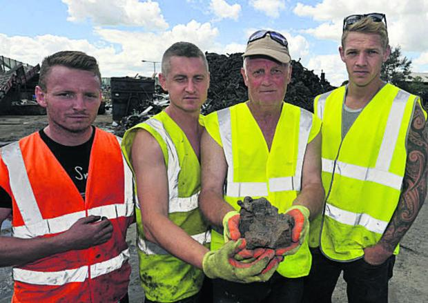 This Is Wiltshire: Shanley's staff Daniel Carr, Janusz Hawryszkiewicz, Arthur Sherman and Keelan Shanley with a 5kg lump of melted steel. Picture by Glenn Phillips