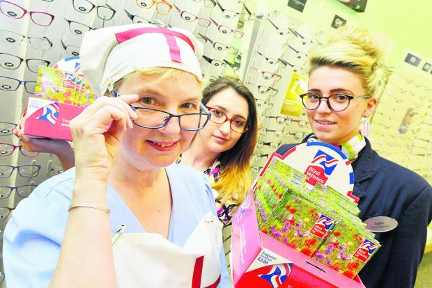 This Is Wiltshire: Debbie Fairfoull, Sophie Jones and Sarah Spratley fundraising at Specsavers for Blind Veterans. Picture: THOMAS KELSEY