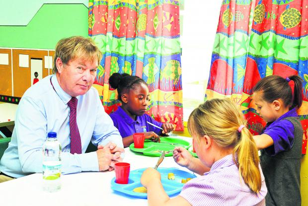 This Is Wiltshire: Goddard Park headteacher Mike Welsh having lunch with pupils