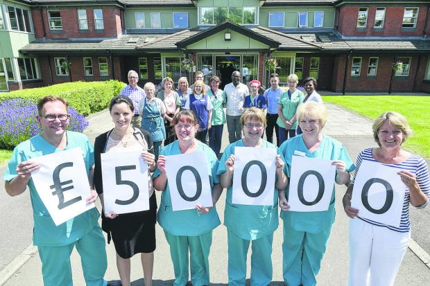 This Is Wiltshire: Staff at Prospect Hospice celebrating reaching £50,000 as part of the Advertiser's 160 Appeal