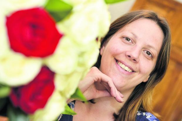 This Is Wiltshire: Centre For Cities has named Swindon fourth in the country for growing small businesses. Pictured is Louise Joachim, the owner of Wendy House Flowers