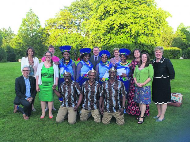 This Is Wiltshire: Wiltshire Community Foundation's Rosemary Macdonald, right, and Kate Robinson, back left celebrate with Swindon Gospel Choir and Community Foundation staff