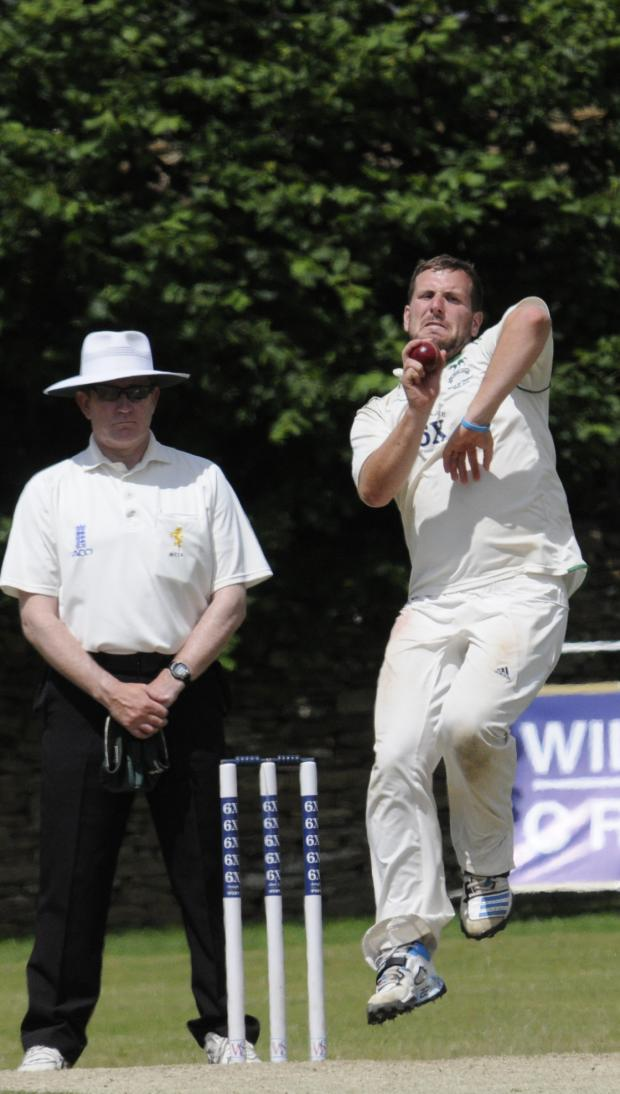 This Is Wiltshire: Jake Roberts, who took eight wickets in total against Dorset, bowls on day three