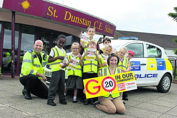This Is Wiltshire: St Dunstan's pupils get advice from PCSO Mark Cook on their walk highlighting speed dangers