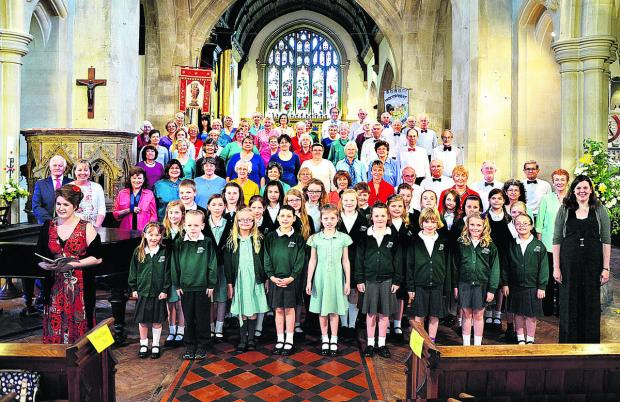This Is Wiltshire: The Athenaeum Singers and Minster School Choir joined forces to present a Spirit of Summer concert at The Minster Church, Warminster, recently. The singers are pictured with soloist Abigail Gostick, front left, conductor Jessi Pywell front right, and acco