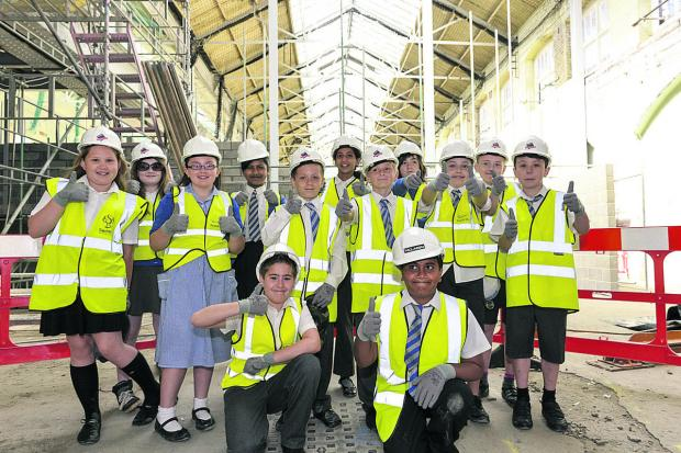 This Is Wiltshire: Pupils from St Mary's Catholic Primary School give a thumbs up during their visit to the Long Shop. Picture: Alex Skennerton