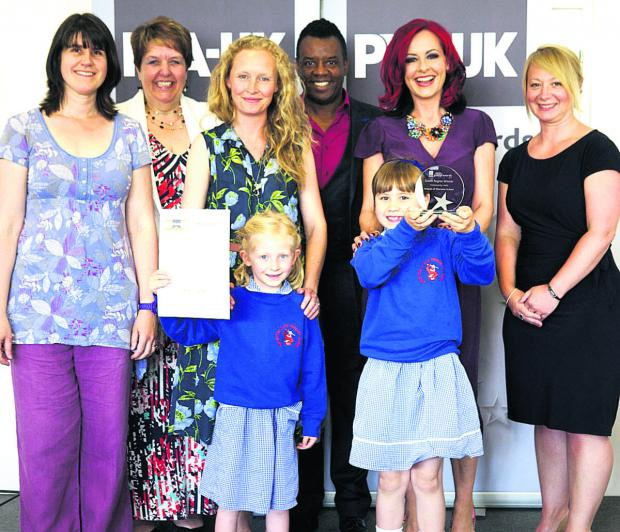 This Is Wiltshire: Fi Picton, Lorraine Petersen OBE, awards' chairman and PTA-UK vice chairman, Kirsty Strachan, TV presenters David and Carrie Grant, Alison Davies, of sponsors Liberty Mutual Insurance, and, front, Jess Picton and Grace Strachan