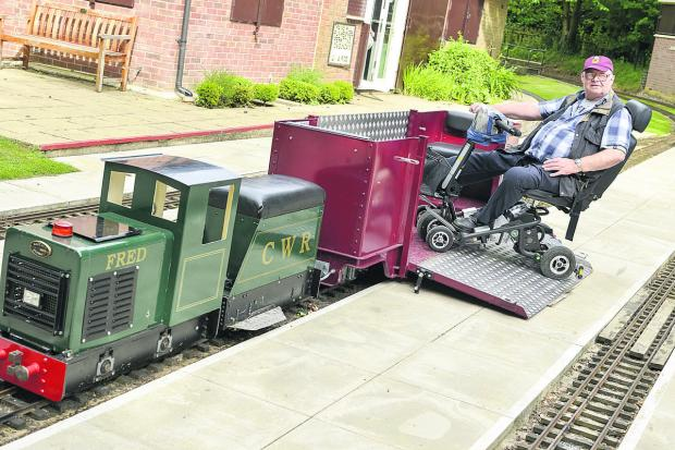 This Is Wiltshire: Allan Wells tries out the new carriage. Picture: ALEX SKENNERTON