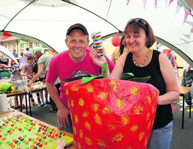 This Is Wiltshire: The lucky dip stall with Jonathan and Helen Peters at the Strawberry Fair