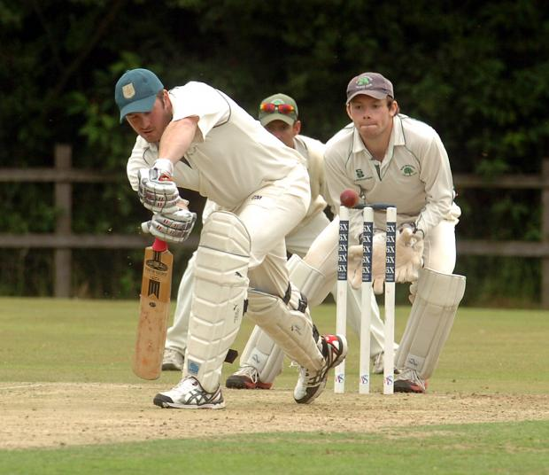 This Is Wiltshire: Rob Palmer (left) was amongst the runs for league leaders Great Bedwyn last weekend