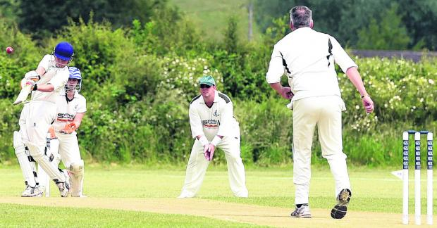 This Is Wiltshire: Trowbridge A's Kyle Oakley hits out during his side's eight-run victory in their Division Five clash at Cherhill