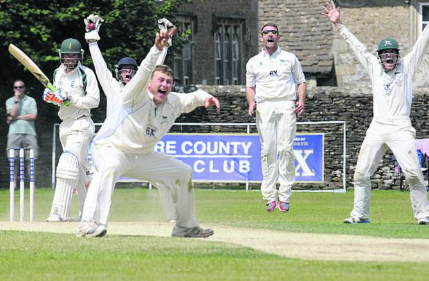 This Is Wiltshire: Wiltshire wicketkeeper Adam Miles celebrates the wicket of last Dorset batsman James Hayman which confirmed the home side's victory