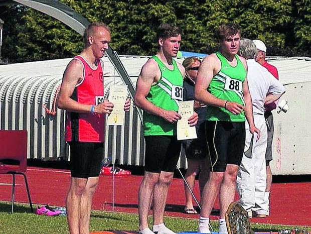 This Is Wiltshire: Will Kennedy (centre) on top of the podium in Yeovil