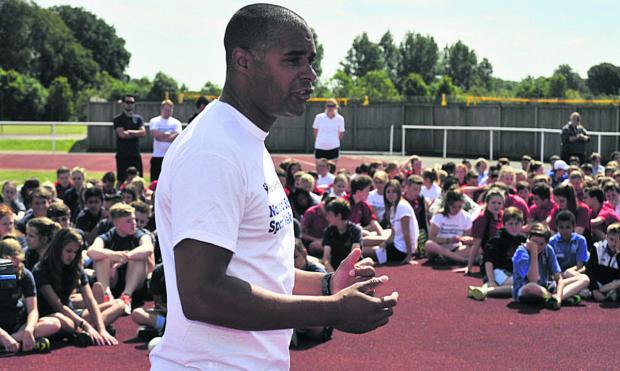 This Is Wiltshire: Olympic gold medallist Jason Gardener speaks to west Wiltshire pupils at the University of Bath on Wednesday