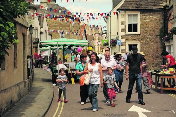 This Is Wiltshire: High Street was bustling for Corsham Food Festival, with shoppers checking the wares of traders