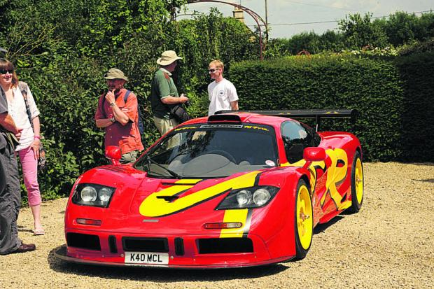 This Is Wiltshire: Visitors admire Nick Mason's Maclaren car at Middlewick House
